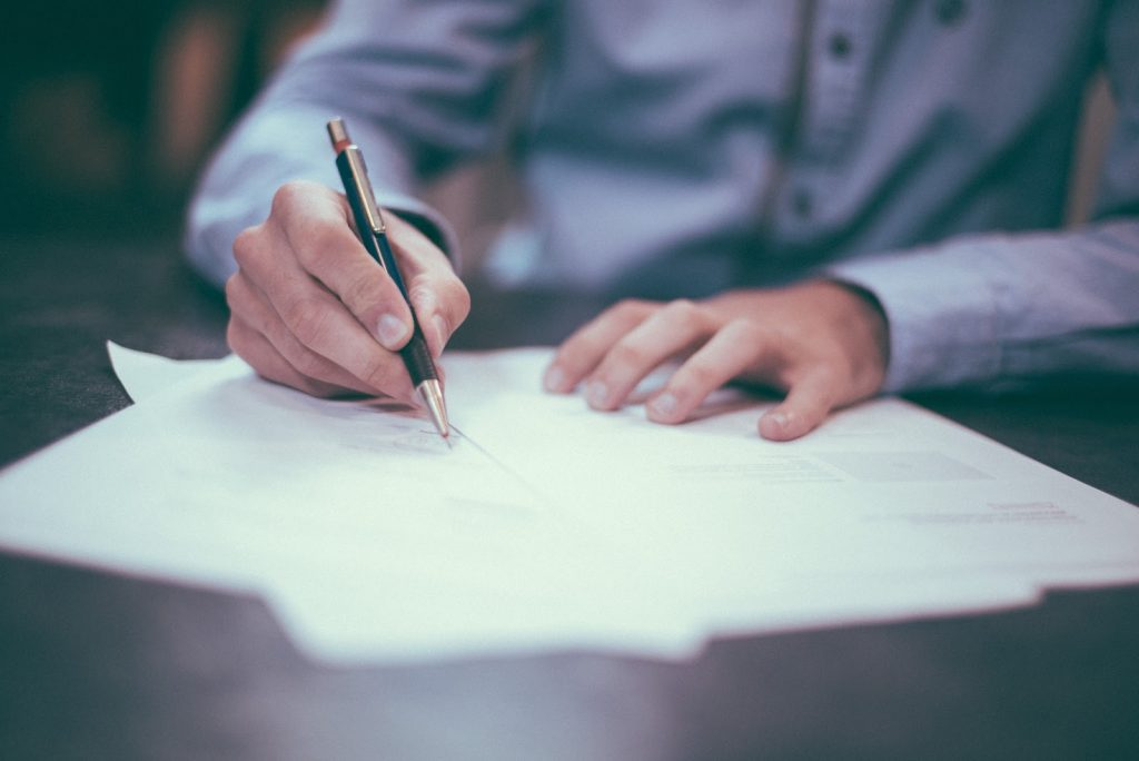 Man writing goodwill letter for bad credit car loan london