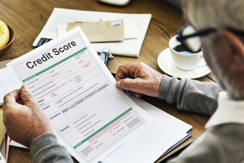 Man checking credit score to see eligibility for bad credit car loan in London.
