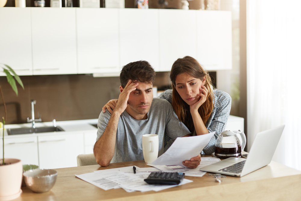 Couple looking into their personal finances and contemplating bankruptcy.
